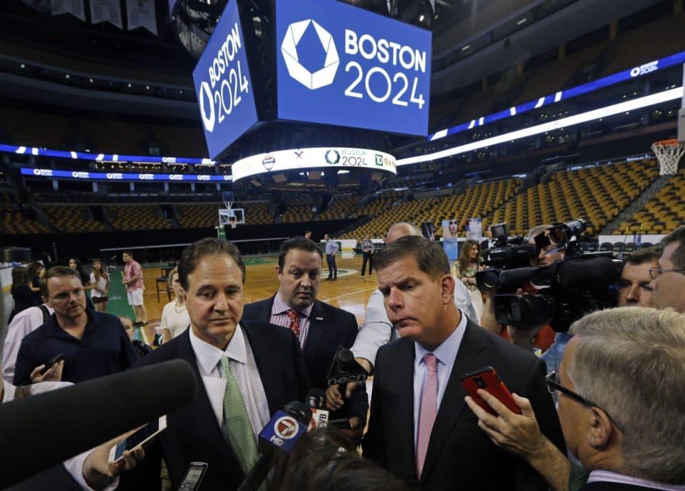 Boston 2024 Chairman Steve Pagliuca, left, and Boston Mayor Marty Walsh, right, speak to reporters in June at TD Garden. (Elise Amendola/AP)