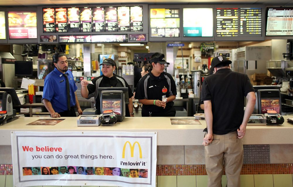 McDonald's employees wait to take orders during a one-day hiring event at a McDonald's restaurant on April 19, 2011 in San Francisco, California. (Justin Sullivan/Getty Images)