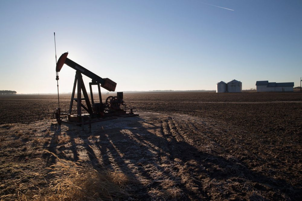 An idled pump jack, once used to extract crude oil from the ground, sits above a well on the edge of a farmers field on January 21, 2015 near Ridgway, Illinois. With oil prices near a 5 1/2-year low, oil companies are beginning to slow drilling operations in the United States.  (Scott Olson/Getty Images)
