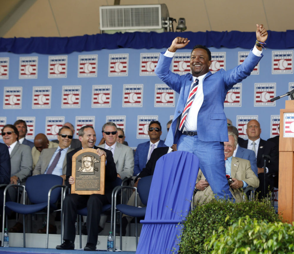 National Baseball Hall of Fame inductee Pedro Martinez dances as he is introduced  during an induction ceremony at the Clark Sports Center on Sunday in Cooperstown, N.Y. (Mike Groll/AP)