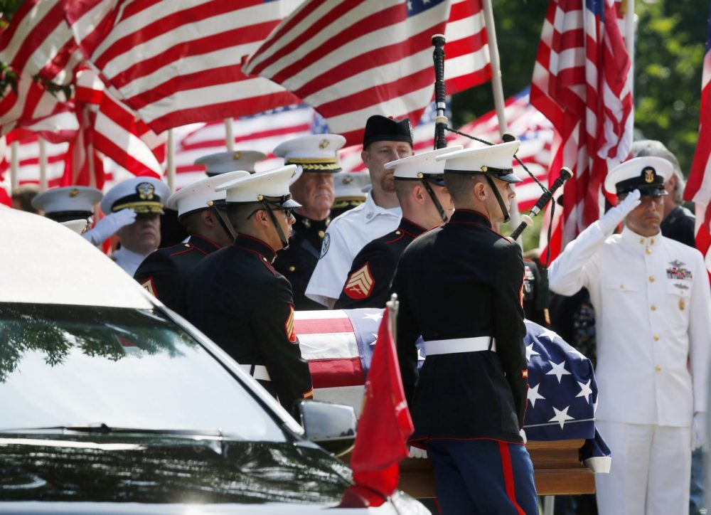 Marine pallbearers carry the casket of Marine Gunnery Sgt. Thomas Sullivan, who died in the July 16 Chattanooga shooting, into a funeral service in Springfield, Mass., on  July 27, 2015. (Michael Dwyer/AP)