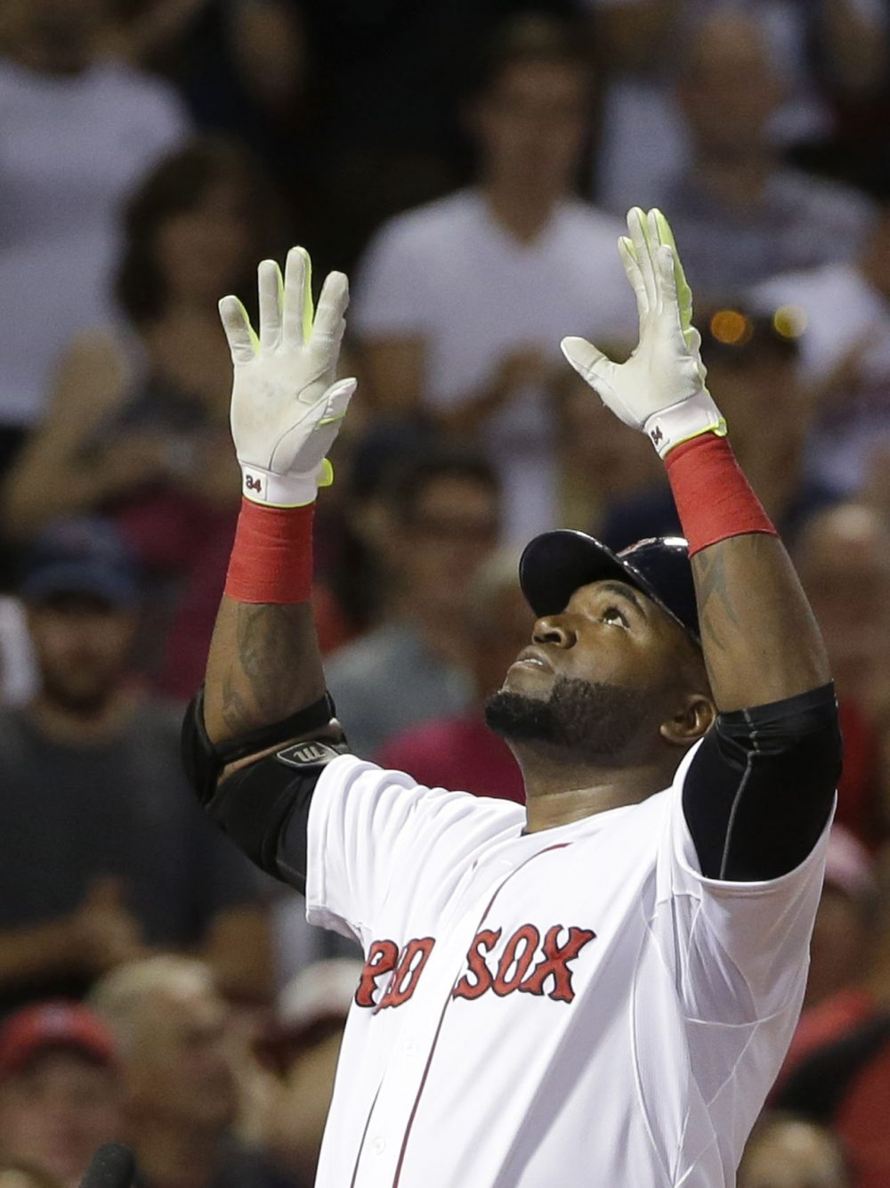 David Ortiz celebrates a three-run home run as he arrives at home plate in the seventh inning of a game against the Tigers at Fenway, Sunday, July 26, 2015. It was the second three-run home run of the evening for Ortiz. (Steven Senne/AP)
