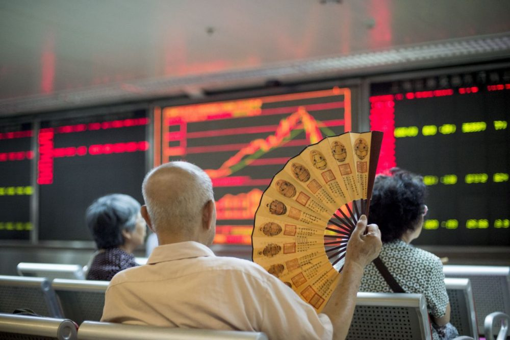 Investors look at screens showing stock market movements at a securities company in Beijing on July 28, 2015. Chinese shares sank on July 28, a day after Shanghai's steepest one-day slide in eight years, defying renewed government vows of support that analysts warned were not enough to soothe nervous investors. (Fred Dufour/AFP/Getty Images)