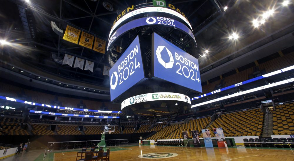 Display boards on and over the parquet floor at the TD Garden remain in place after a news conference, Thursday, June 18, 2015, in Boston, where it was announced that TD Garden would be the site of the Olympic and Paralympic basketball finals and Olympic gymnastics and trampoline if the city wins a bid to host the 2024 games. (Elise Amendola/AP)