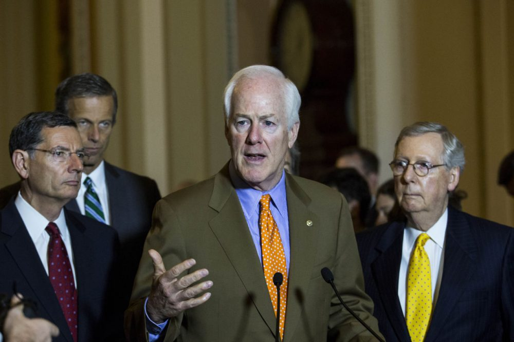 From left, Sen. John Barrasso (R-WY),  Sen. John Thune (R-SD), Sen. John Cornyn (R-TX) and Senate Majority Leader Mitch McConnell (R-KY) take questions during a news conference after a meeting with Senate Republicans, on Capitol Hill, July 28, 2015 in Washington, DC.  On Tuesday, the Senate is continuing to work toward passing a long-term extension of a federal highway bill that is set to expire on Friday. (Drew Angerer/Getty Images)