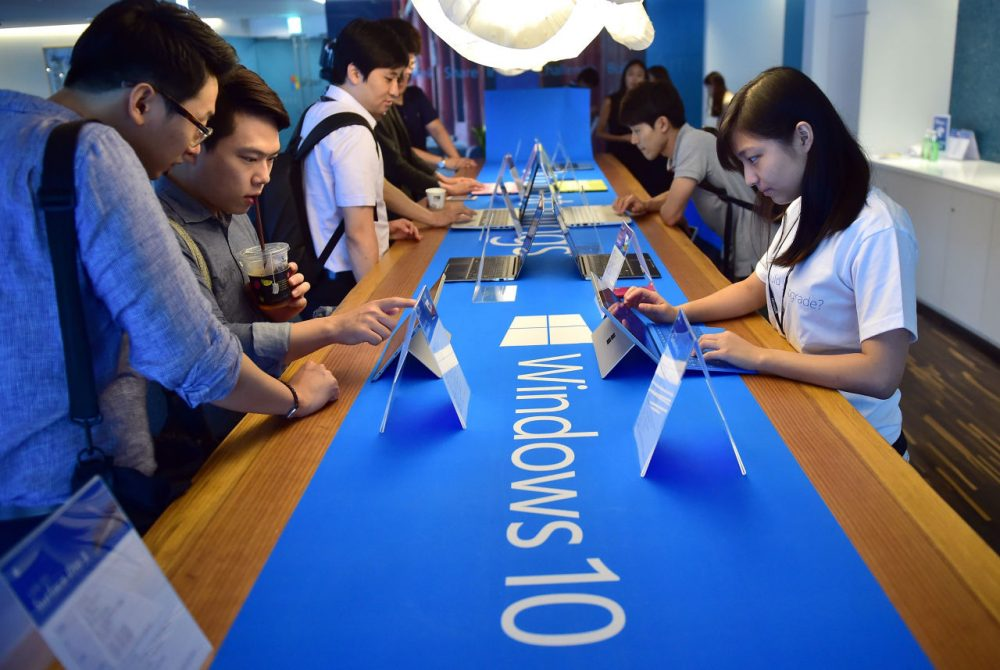 Visitors try out Windows 10, the latest operating system from US software giant Microsoft, during a launch event in Seoul on July 29, 2015. ( Jung Yeon-Je/AFP/Getty Images)