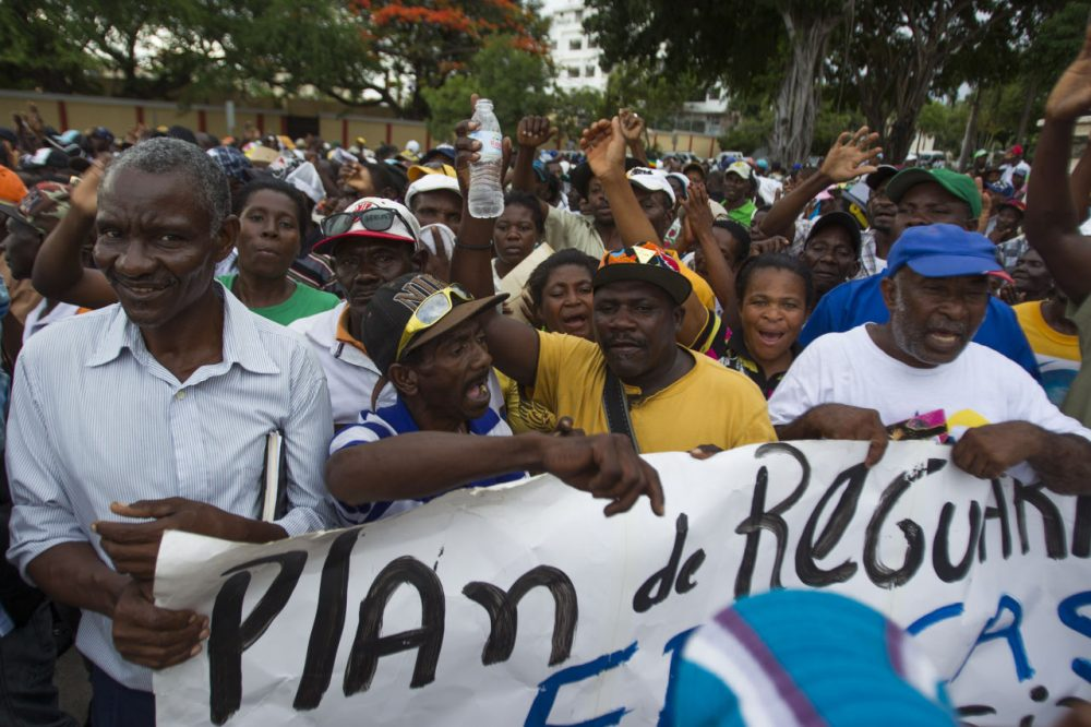 Haitian sugar cane workers march to the National Palace in Santo Domingo to protest about the deadline to enter the National Plan of Regularization of Foreigners in Dominican Republic, on June 17, 2015. (Erika Santelices/AFP/Getty Images)