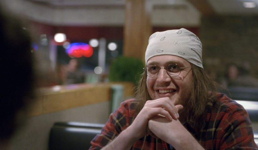 """Jason Segel, as David Foster Wallace, in a scene from the film, """"The End of the Tour."""" The movie opens in U.S. theaters on Friday. (A24 via AP)"""