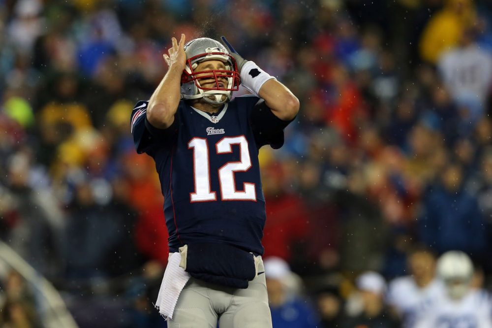 New England Patriots quarterback Tom Brady will be suspended for the first four games of the 2015 season for his presumed actions in the  'Deflategate' scandal. Brady lost his appeal to reduce or eliminate the suspension this week. (Elsa/Getty Images)