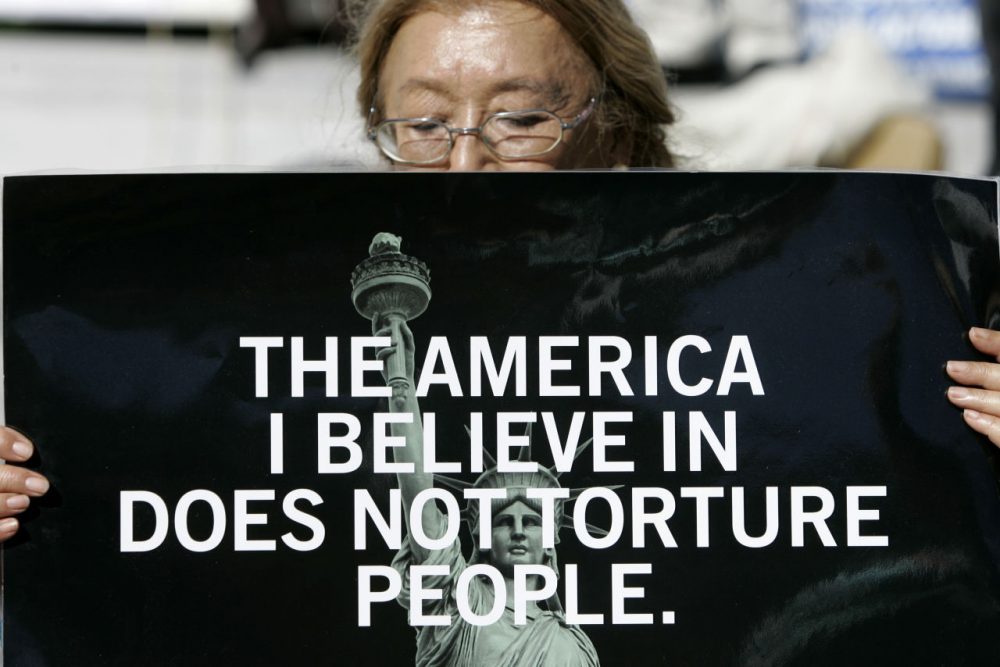 As far back as 2007, protesters rallied against the American Psychological Association participating in military interrogations at Guantanamo Bay. (Jeff Chiu/AP)