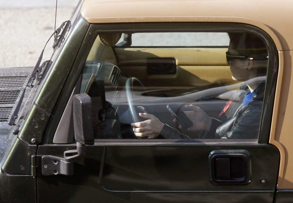 In this file photo, a driver uses their cellphone in Los Angeles in 2011. (Damian Dovarganes/AP)
