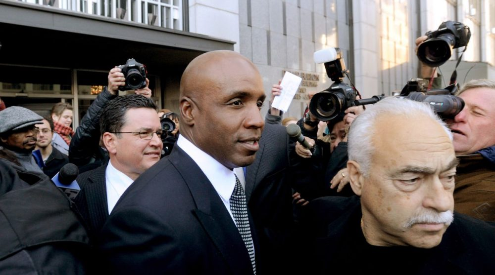 Former baseball player Barry Bonds leaves federal court after being sentenced for obstructing justice in a government steroids investigation in, Dec. 2011, in San Francisco.  (AP Photo/Noah Berger)