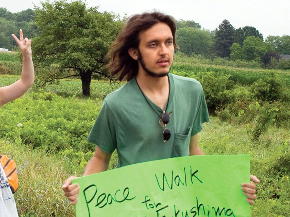 Alexander Ciccolo in 2012, participating in a peace walk through Ontario.  (Dave Fraser/Northumberland News via AP)