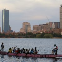 E.M. Swift: The hub's Olympic bid was so delusional, it was misleading. In this photo, a boat glides along the Cambridge, Mass., side of the Charles River, Monday, July 27, 2105, in front of the Boston skyline, behind. The U.S. Olympic Committee officially severed ties with Boston on Monday, saying it was exploring other options amid lackluster public support and concerns from elected leaders and organized opposition about the impact to taxpayers. (Steven Senne/AP)