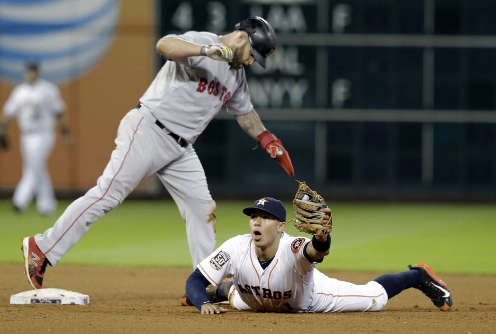 Houston Astros shortstop Carlos Correa can't believe Red Sox's Mike Napoli is safe at second base. (Pat Sullivan/AP)
