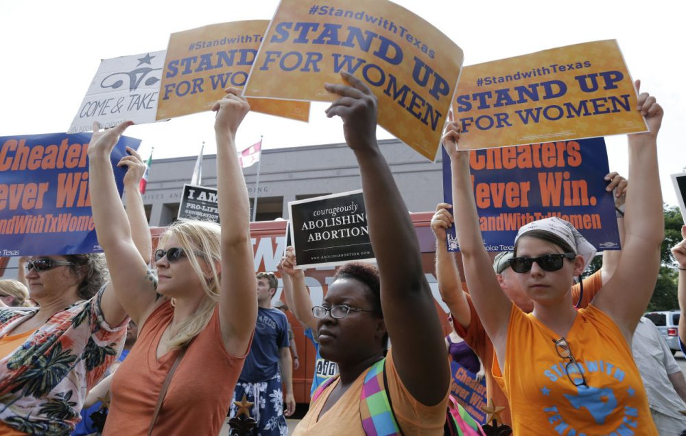 Opponents and supporters of an abortion bill hold signs outside the Texas Capitol on July 9 in Austin. (Eric Gay/AP)