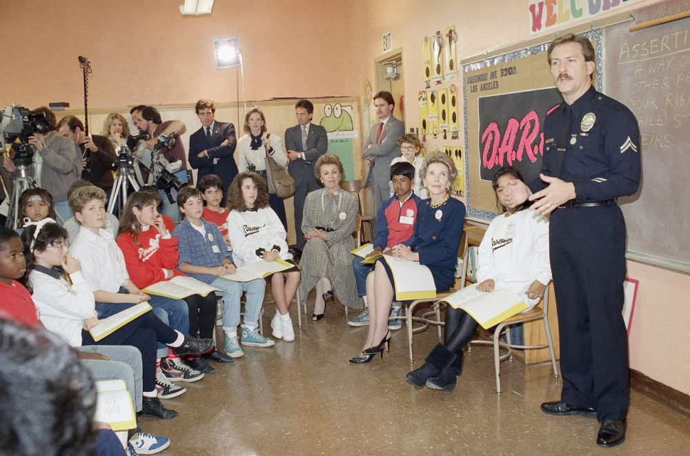"First Lady Nancy Reagan sits with students at a presentation by the Los Angeles police department's Project D.A.R.E. (Drug Abuse Resistance Education). Such education has moved beyond the ""just say no"" approach, according to Lee Ellenberg. (Nick Ut/AP)"