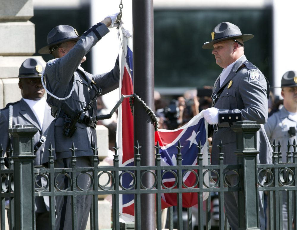 An honor guard from the South Carolina Highway patrol lowers the Confederate battle flag as it is removed from the Capitol grounds Friday in Columbia, South Carolina. (John Bazemore/AP)