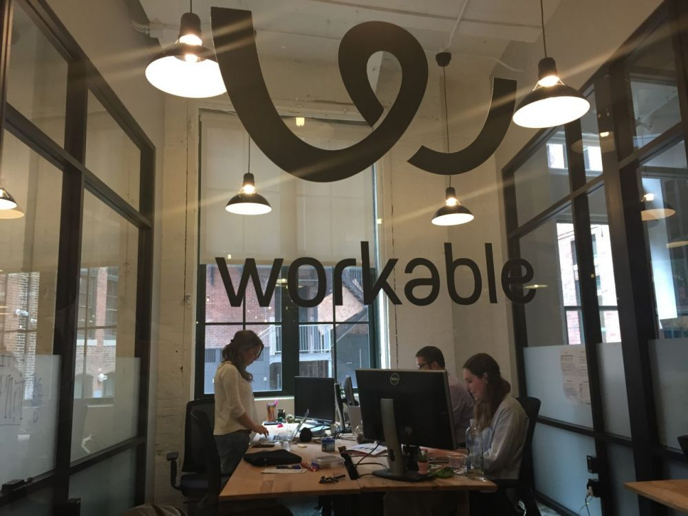 At the South Boston office of Workable, employees keep one eye on events in Greece. (Curt Nickisch/WBUR)