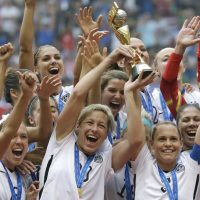 "Andrea Kremer: ""The overall prize money for male soccer players in the World Cup tournament is 24 times what FIFA allocates for the women's bracket. Talk about a FIFA scandal! "" Pictured: The United States Women's National Team celebrates with the trophy after they beat Japan 5-2 in the FIFA Women's World Cup soccer championship in Vancouver, British Columbia, Canada, Sunday, July 5, 2015. (Elaine Thompson/AP)"