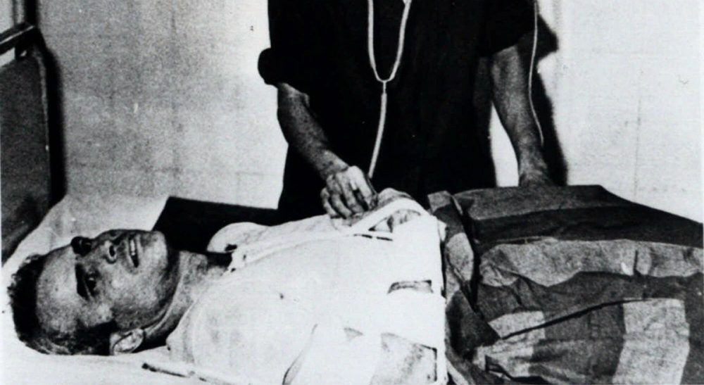 """Laura McTaggart: """"In the case of John McCain, the word in all its weighty glory hardly seems enough."""" Pictured: John McCain is administered to at a Hanoi, Vietnam, hospital as a prisoner of war in 1967. Republican presidential candidate Donald Trump criticized Sen. John McCain's military record at a conservative forum Saturday, July 18, 2015, saying the party's 2008 nominee and former prisoner of war was a """"war hero because he was captured. I like people who weren't captured."""" McCain spent 20 years in the Navy, a quarter of it in a Vietnamese prisoner of war camp after his jet was shot down over Hanoi during a bombing mission Oct. 26, 1967. (AP Photo)"""