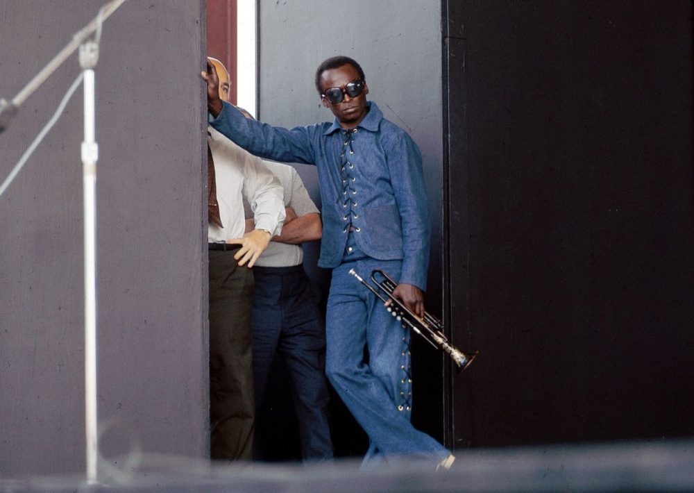 Miles Davis at Newport 1969, waiting with George Wein in the wings. (David Redfern)