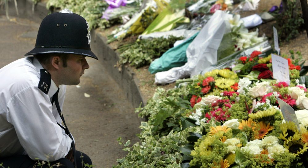 """Susan Pollack: """"The park has endured war and terrorism, yet it stands as a curious and inspiring place that celebrates life over death, civilization over destruction, peace over war."""" Pictured: A British police officer reads messages placed on flowers in the memory of the 7/7/05 attacks in central London's Tavistock Square, site of the bombed No. 30 bus, in central London. (Lefteris Pitarakis/AP)"""