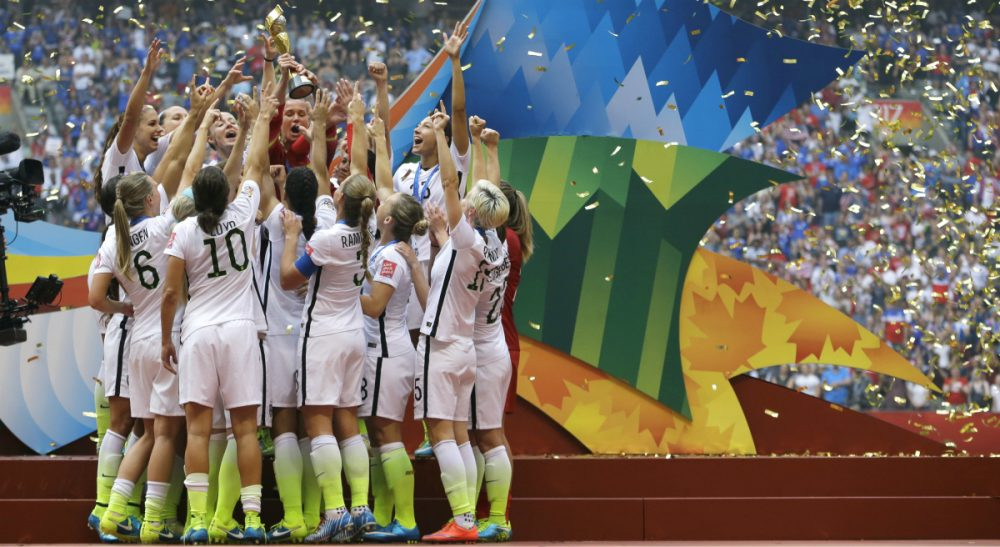 The United States Women's National Team celebrates with the trophy as confetti falls after they beat Japan 5-2 in the FIFA Women's World Cup soccer championship in Vancouver, British Columbia, Canada, Sunday, July 5, 2015. (Elaine Thompson/AP)