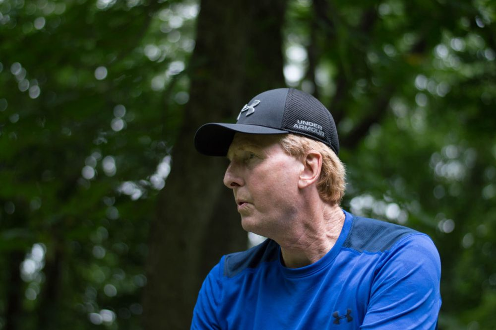 Whittington lines up a putt at a disc golf course in Pittsburgh. The two-time Disc Golf champion is preparing for his third title. (Liz Reid/Only A Game)