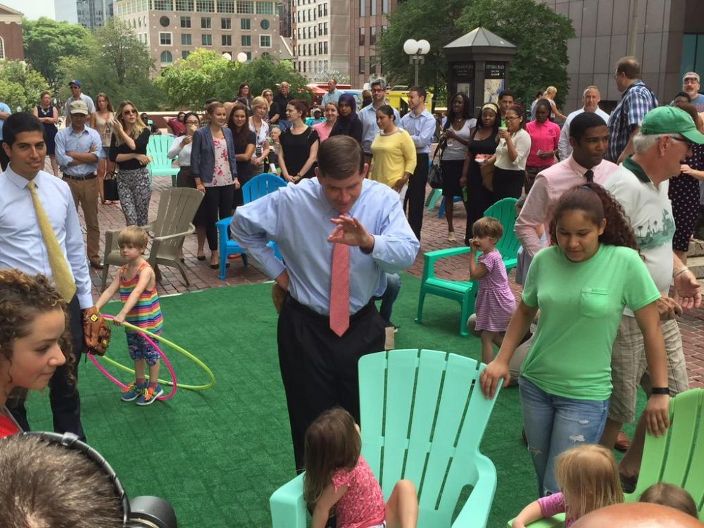 "Boston Mayor Marty Walsh greets guests Wednesday afternoon during a launch party for the city's new ""front lawn"" on City Hall Plaza. (Jack Lepiarz/WBUR)"