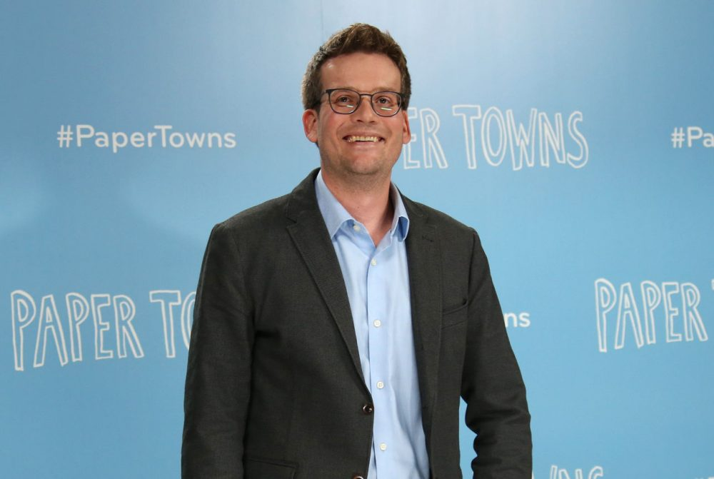 Author John Green poses for photographers at the photo call for the film Paper Towns in Claridges, central London , Thursday, 18 June, 2015. (Joel Ryan/Invision/AP)