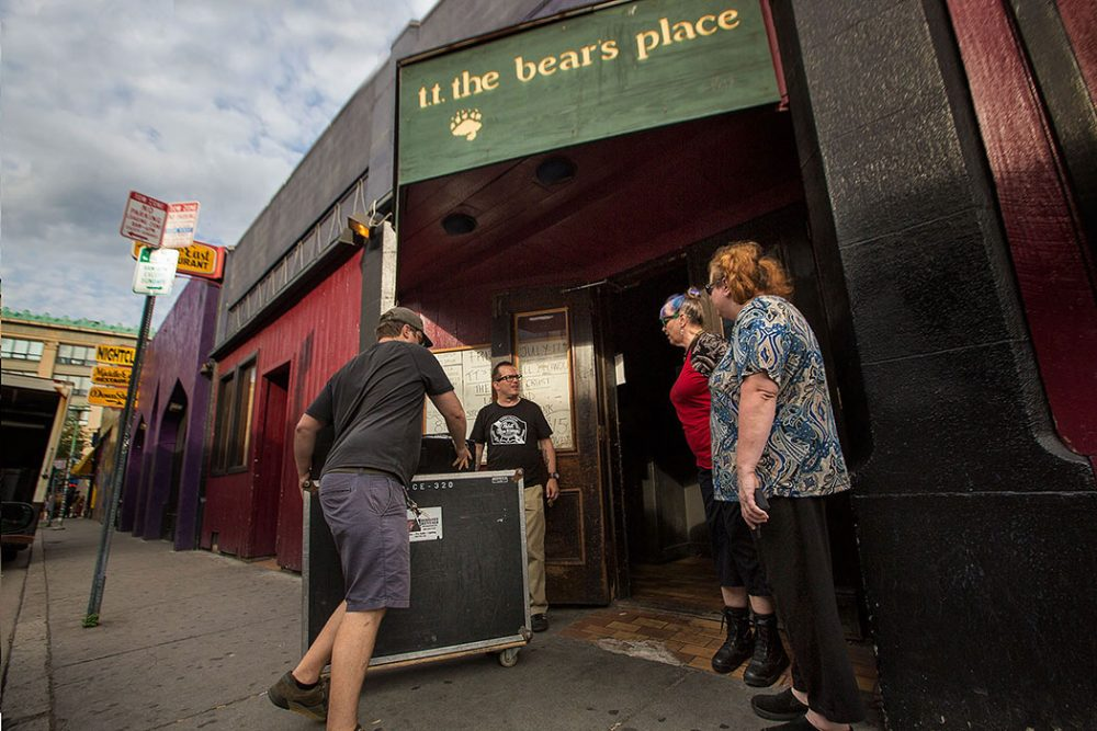 As manager Kevin Patey opens the doors at T.T. the Bear's, Jutes Leeden and Tina Forsyth inquire about ticket sales wanting to see the band Stop Calling Me Frank during the clubs final week of shows. (Jesse Costa/WBUR)