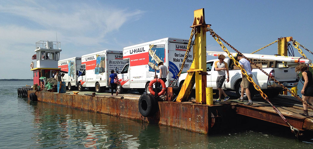 U-Haul box trucks loaded with art were barged out to Georges Island last week for the Isles Arts Initiative. (Amy Archambault)