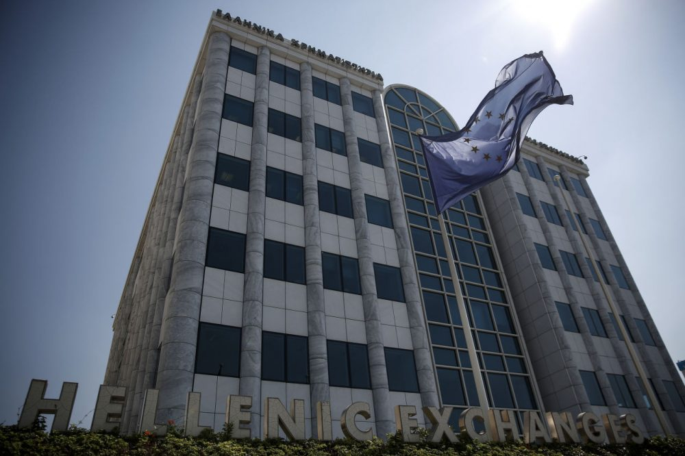 A European Union (EU) flag flutters outside the Athens' Stock Exchange in Athens, Greece, Monday, Aug. 3, 2015. Greece's main stock index plunged over 22 percent as it reopened Monday after a five-week closure, giving investors their first opportunity since June to react to the country's latest economic crisis.  (Yorgos Karahalis/AP Photo)