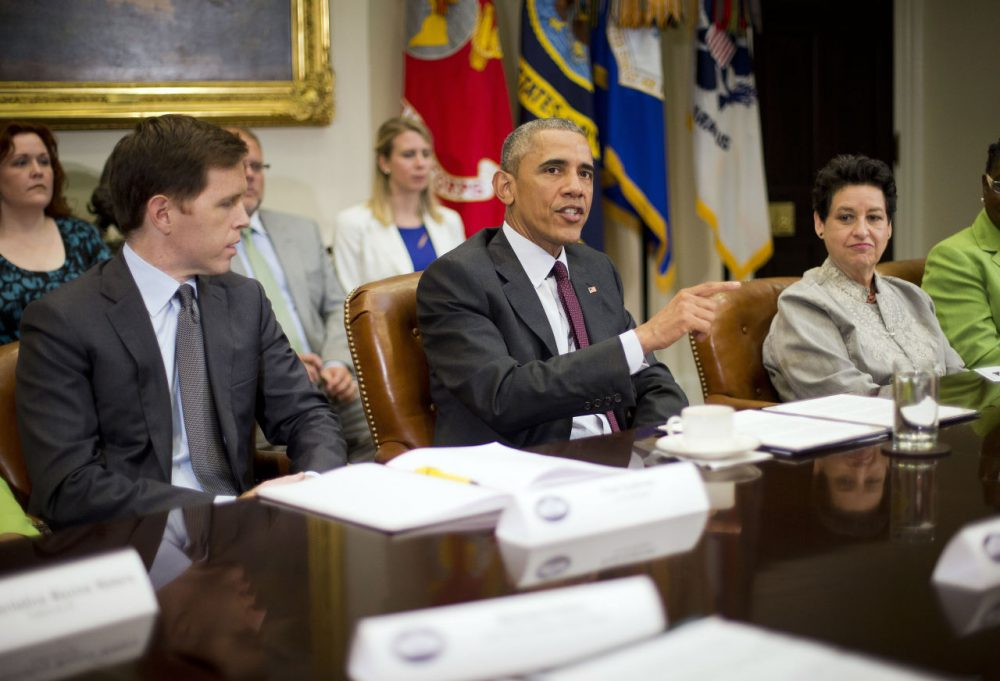 President Barack Obama, center, with Paul Sullivan, left, Vice President of International Business Development at Acrow Bridge, and Susan Jaime, right, CEO Ferra Coffee International, speaks during his meeting with small business owners to discuss the importance of the reauthorization of the Export-Import Bank in the White House on July 22, 2015. (Pablo Martinez Monsivais/AP)