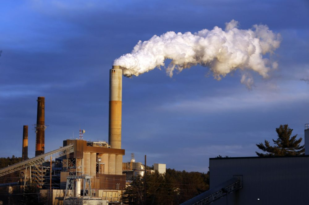 A plume of steam billows from the coal-fired Merrimack Station in Bow, N.H. (Jim Cole/AP Photo)