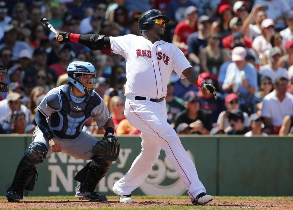 Red Sox designated hitter David Ortiz follows through on a RBI double during the third inning of a baseball game at Fenway, Sunday, Aug. 2, 2015. (Winslow Townson/AP)