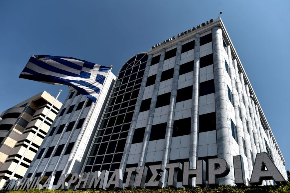 A Greek flag waves outside the Athens Stock Exchange on Aug. 3, 2015 when the market reopened after a five-week closure. (Aris Messinis/AFP/Getty Images)