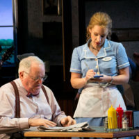 """Jessie Mueller stars in the stage adaptation of the 2007 indie film """"Waitress,"""" showing now at the American Repertory Theater. Here in a scene with Dakin Matthews. (Photo by Evgenia Eliseeva and Courtesy American Repertory Theater)"""