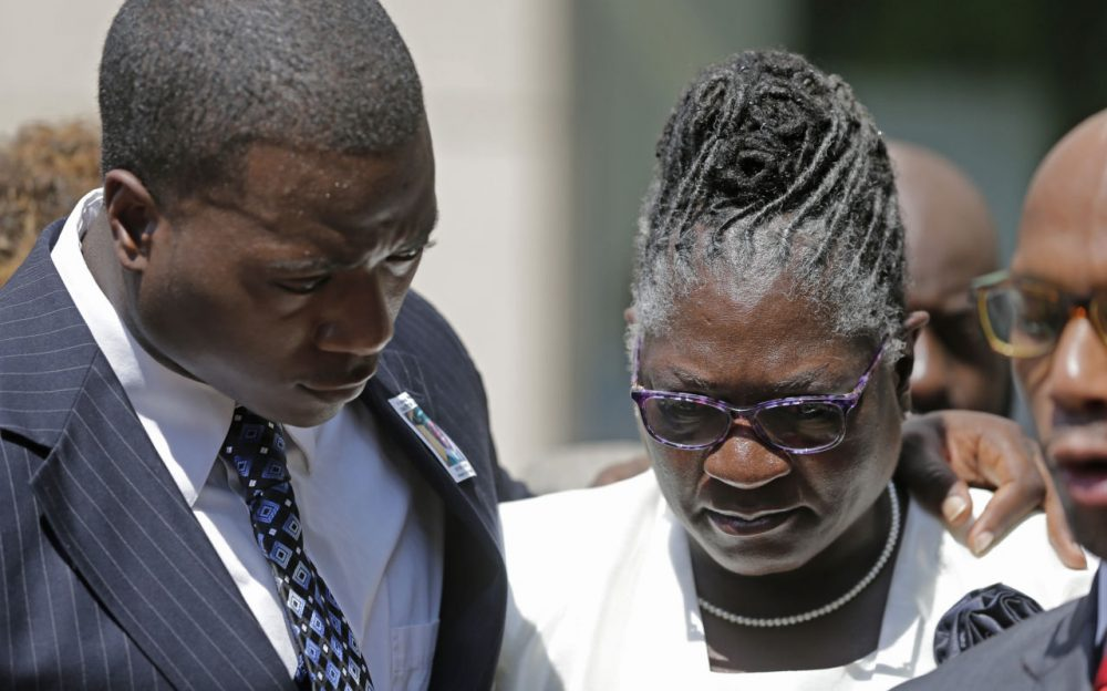 Georgia Ferrell, right, mother of Jonathan Ferrell, is hugged by her son William Ferrell, left, during a news conference on the first day of the trial of former Charlotte-Mecklenburg police Officer Randall Kerrick, in Charlotte, N.C., Monday, July 20, 2015. Investigators say Kerrick shot Jonathan Ferrell, who was unarmed, 10 times during an investigation of a possible home invasion. (Chuck Burton/AP)