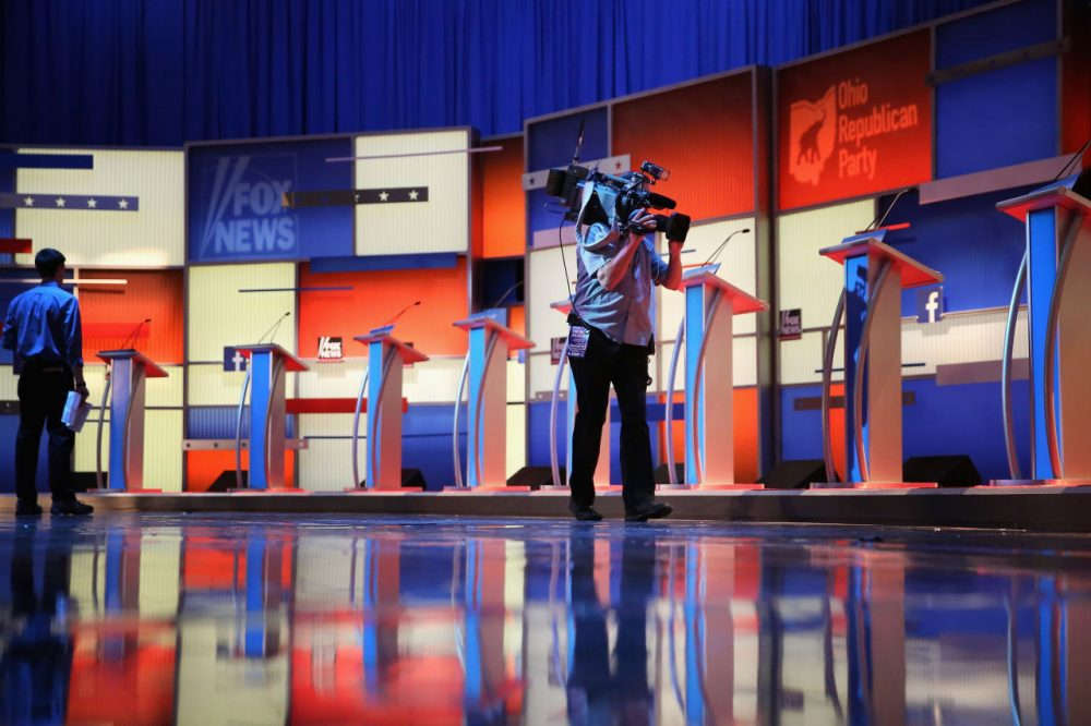 The row of ten podiums for the Republican presidential debate is set on stage at The Quicken Loans Arena August 6, 2015 in Cleveland, Ohio. (Chip Somodevilla/Getty Images)
