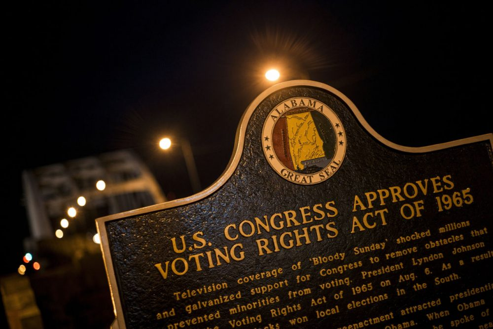 A plaque describes the 1965 Voting Rights Act at the base of the Edmund Pettus Bridge, where route 80 crosses the Alabama River, on March 4, 2015 in Selma, Alabama. (Brendan Smialowski/AFP/Getty Images)