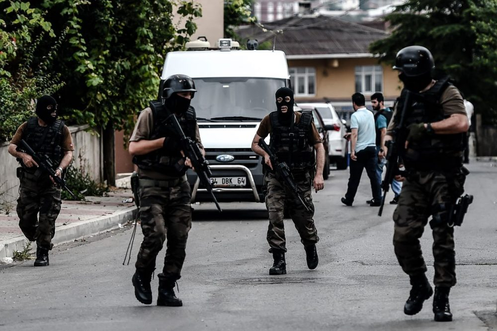 Turkish special police officers patrol in the street after clashes with attackers today at the Sultanbeyli district in Istanbul. The city was shaken by twin attacks on the U.S. consulate and a police station as tensions spiral amid the government's air campaign against Kurdish militants. Clashes had raged overnight following the attack on the police base, which left 10 people wounded including three police. The suspected affiliation of the slain militants was not made clear. (Ozan Kose/Getty Images)