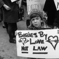 A youthful picketer voices opposition to the New York State abortion laws in Midtown Manhattan March 21, 1969, in front of Gov. Nelson A. Rockefeller's office. (Anthony Camerano/AP)