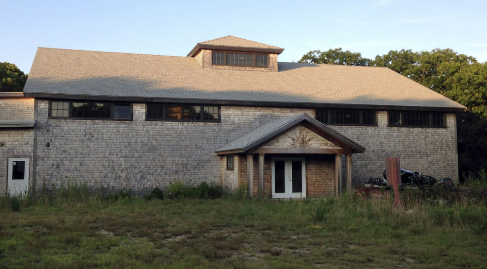 The state and the Aquinnah Wampanoag are asking a federal judge to settle whether the tribe can turn this Martha's Vineyard community center into a gambling house. (Philip Marcelo/AP)