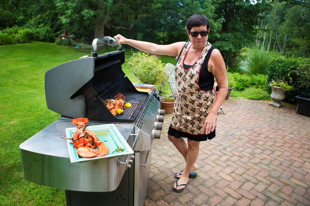 Kathy Gunst grills lobsters in her backyard in Maine. (Jesse Costa/WBUR)