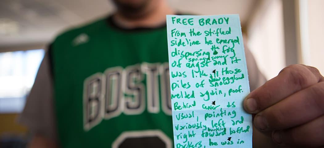"Jim Behrle, poet-wrangler of the Boston Poetry Marathon, with his poem, ""Free Brady."" (Jesse Costa/WBUR)"