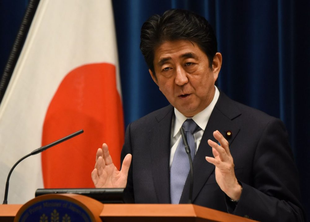 Japanese Prime Minister Shinzo Abe made an anniversary statement in recognition of the 70th anniversary of Japan's surrender from World War II, saying that neighboring nations will scrutinize for signs of sufficient remorse over Tokyo's past militarism. Abe expressed deep remorse over World War II and said previous national apologies were unshakable, but emphasized future generations should not have to keep saying sorry. (Toru Yamanaka/Getty Images)