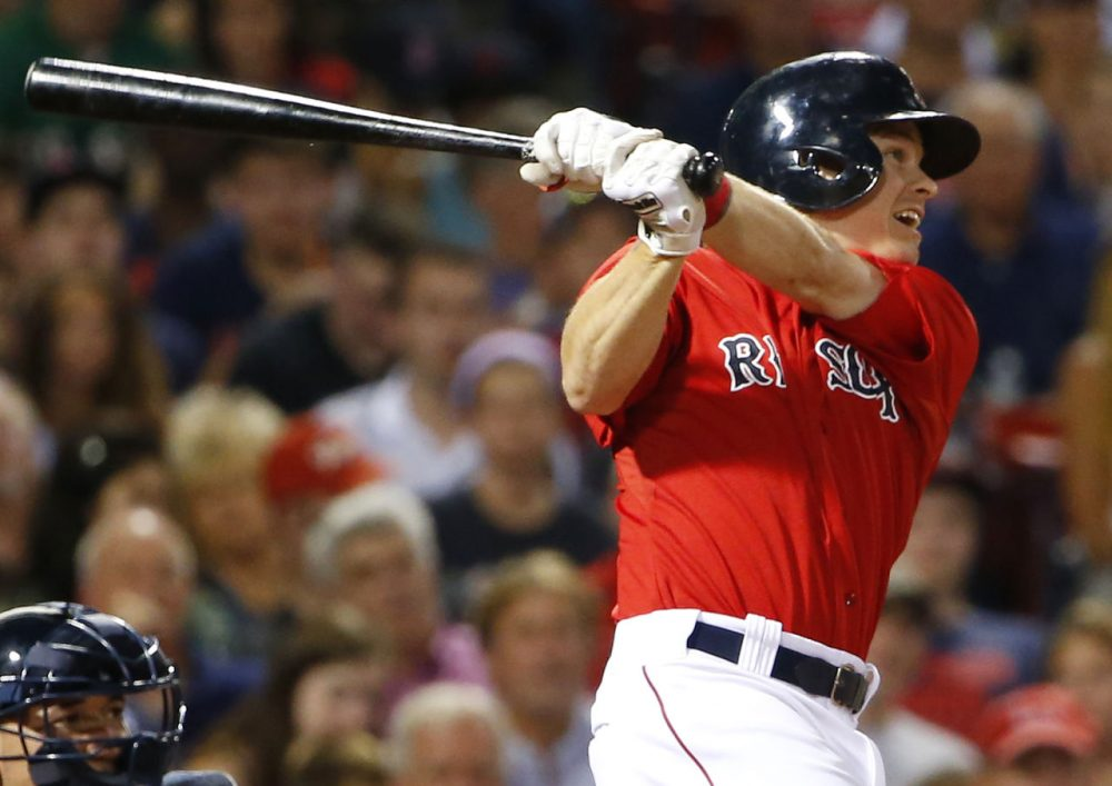 Boston Red Sox's Brock Holt watches his two-run triple against the Seattle Mariners during the third inning at Fenway on Aug. 14, 2015. (Winslow Townson/AP)