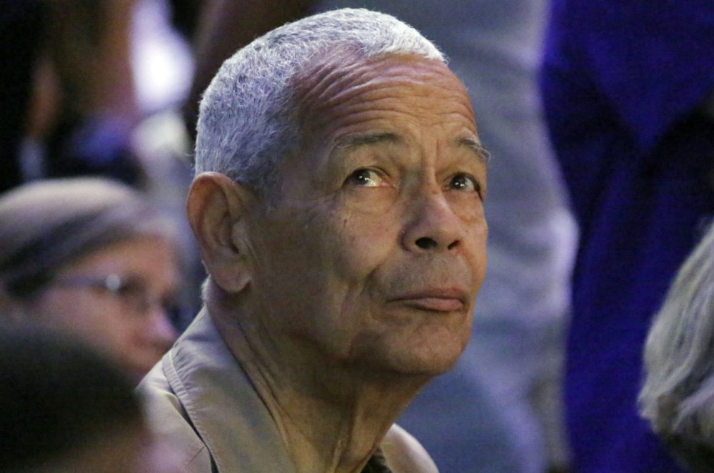Julian Bond, one of the founders of the Student Nonviolent Coordinating Committee and an American social activist, watches a presentation on overhead video screens at the 50th Anniversary Freedom Summer conference at Tougaloo College in Jackson, Miss., Thursday, June 26, 2014.  (AP Photo/Rogelio V. Solis)